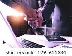 businessmen shaking hands with... | Shutterstock . vector #1295655334