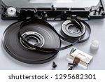 disassembled audio cassette... | Shutterstock . vector #1295682301