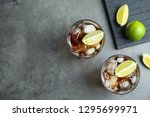 glasses of cocktail with cola ... | Shutterstock . vector #1295699971