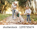 happy beautiful family with dog ... | Shutterstock . vector #1295735674