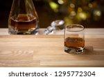 whiskey glass wooden... | Shutterstock . vector #1295772304
