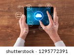 hand touching tablet with cloud ... | Shutterstock . vector #1295772391