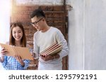 smiling young couples reading... | Shutterstock . vector #1295792191