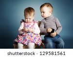little boy and girl playing... | Shutterstock . vector #129581561