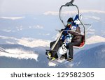 skiers couple on a ski lift | Shutterstock . vector #129582305