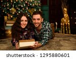 couple with christmas present | Shutterstock . vector #1295880601