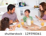 family laughing around... | Shutterstock . vector #129598361