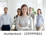 confident young female leader ... | Shutterstock . vector #1295995831