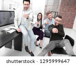 smiling business team pointing... | Shutterstock . vector #1295999647