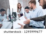 business team is concerned... | Shutterstock . vector #1295999677