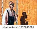 young black man wearing casual... | Shutterstock . vector #1296015301