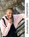 young black man wearing casual... | Shutterstock . vector #1296015304