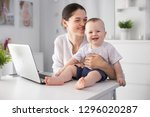 young mother working in a... | Shutterstock . vector #1296020287