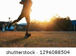 young people is running on lawn ... | Shutterstock . vector #1296088504