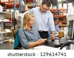 business colleagues working at... | Shutterstock . vector #129614741