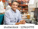 businessman working at desk in... | Shutterstock . vector #129614795