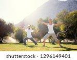 yoga at park. senior family... | Shutterstock . vector #1296149401