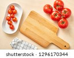 raw tomato on table with... | Shutterstock . vector #1296170344