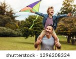 young smiling boy playing with... | Shutterstock . vector #1296208324