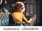 female entrepreneur working on... | Shutterstock . vector #1296208354
