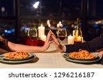 romantic couple touching hands... | Shutterstock . vector #1296216187