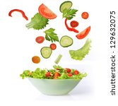 green fresh salad in bowl close ... | Shutterstock . vector #129632075