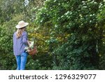 woman with wicker basket and... | Shutterstock . vector #1296329077