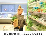 woman buying vegetables at the... | Shutterstock . vector #1296472651
