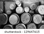 old wooden barrels pilled up in ... | Shutterstock . vector #129647615