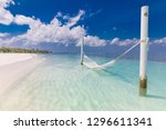 white hammock with clear blue... | Shutterstock . vector #1296611341