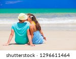 back view of couple sitting on... | Shutterstock . vector #1296611464