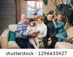 extended cheerful family enjoys ... | Shutterstock . vector #1296633427