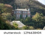 house nestled in the trees in... | Shutterstock . vector #1296638404
