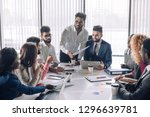 young business team having a... | Shutterstock . vector #1296639781