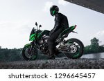 Motorcyclist Stop Under The...