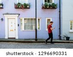 man walking by beautiful... | Shutterstock . vector #1296690331