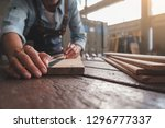 carpenter working with... | Shutterstock . vector #1296777337