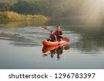 father and daughter rowing boat ... | Shutterstock . vector #1296783397