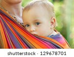 Baby In Sling Looking Outdoor....