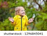kids play in autumn rain. child ...   Shutterstock . vector #1296845041