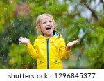 kids play in autumn rain. child ... | Shutterstock . vector #1296845377