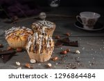homemade muffins with chocolate ... | Shutterstock . vector #1296864484