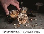 man is taking homemade muffin... | Shutterstock . vector #1296864487