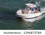 small white sport fishing boat... | Shutterstock . vector #1296873784