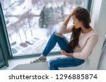 winter depressed sad girl... | Shutterstock . vector #1296885874