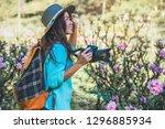 asian woman travel nature....   Shutterstock . vector #1296885934