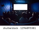 people in the cinema watching a ... | Shutterstock . vector #1296895381