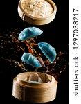 flying  blue chinese dumplings... | Shutterstock . vector #1297038217