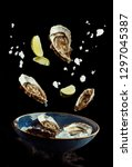 flying oysters with lime and... | Shutterstock . vector #1297045387