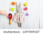 baby hand touch toy rabbit doll ... | Shutterstock . vector #1297049107